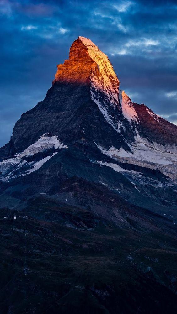 sunrise hitting mountain top