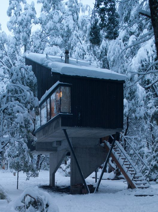 modern elevated home in the snow