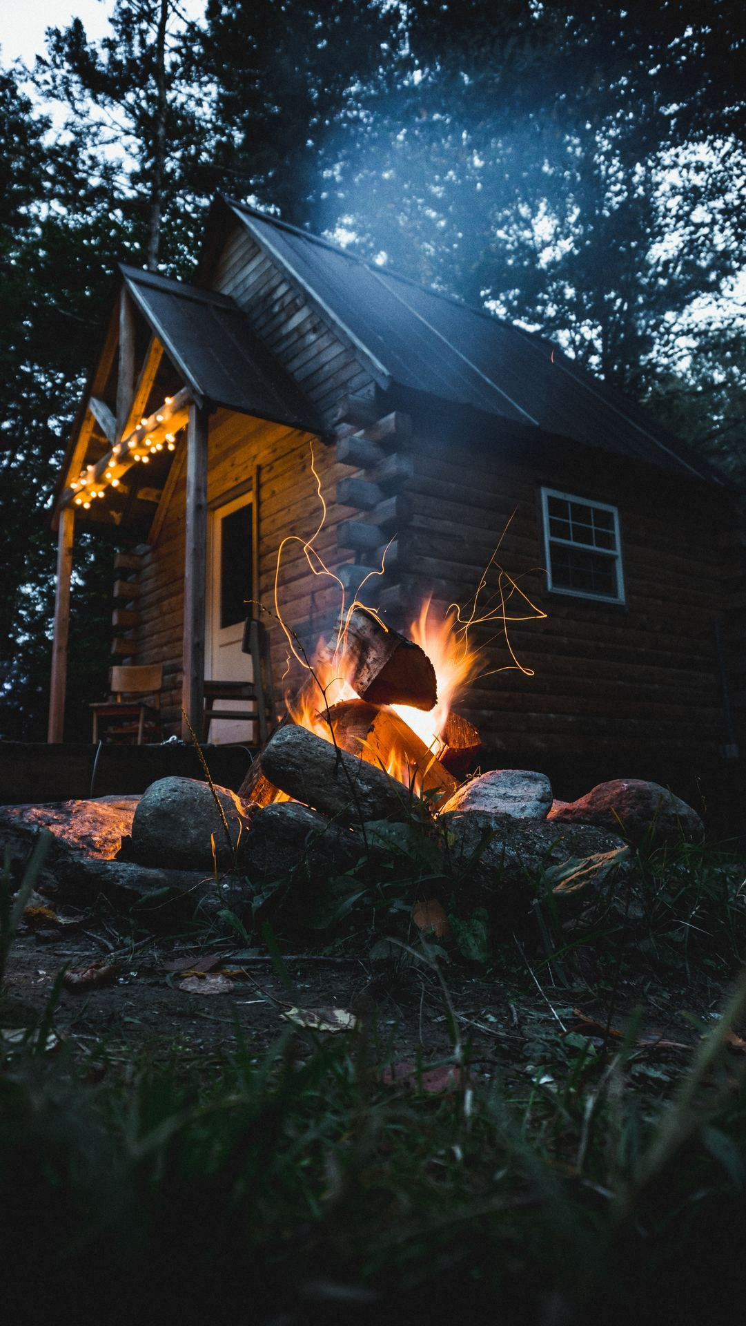 campfire outside of cabin