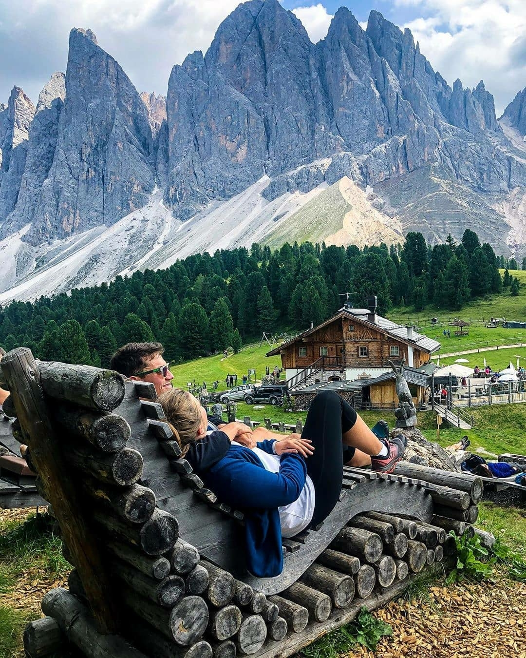 couple relaxing with view of mountains