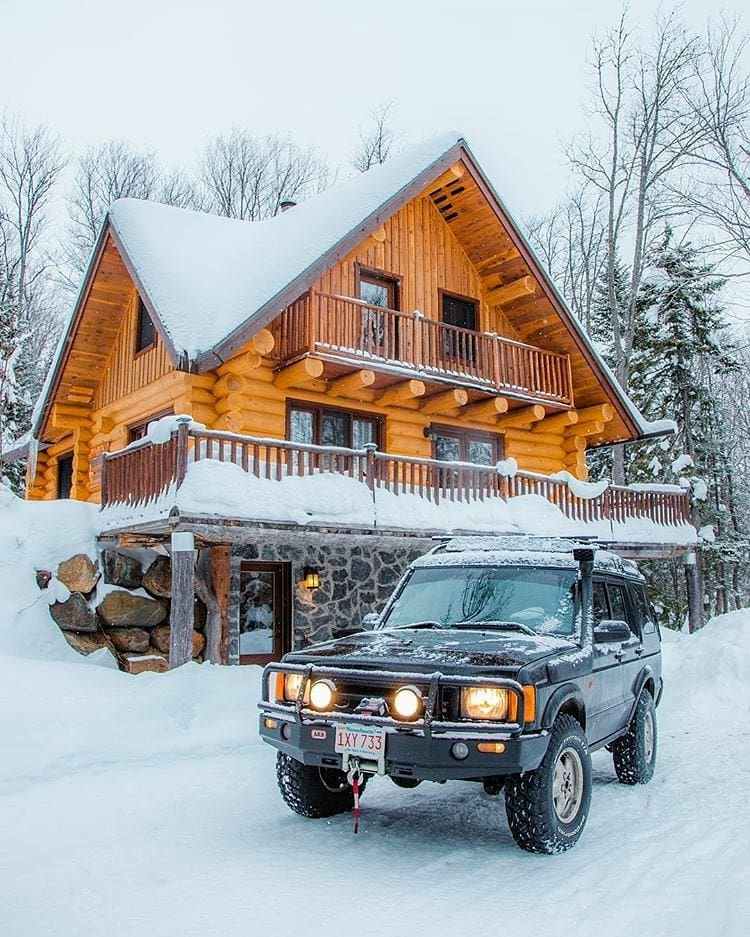 truck in front of snowy cabin