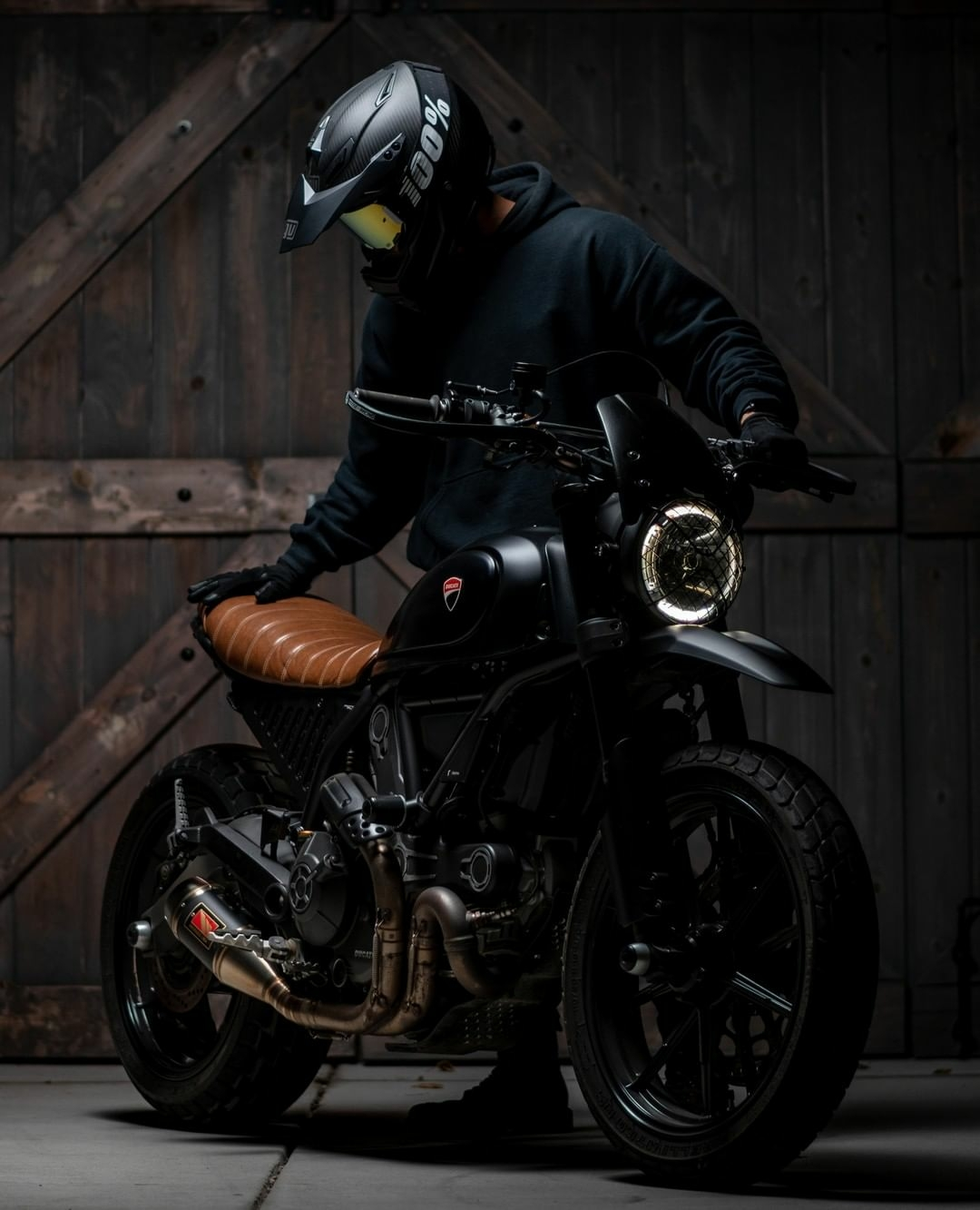 man standing next to motorcycle