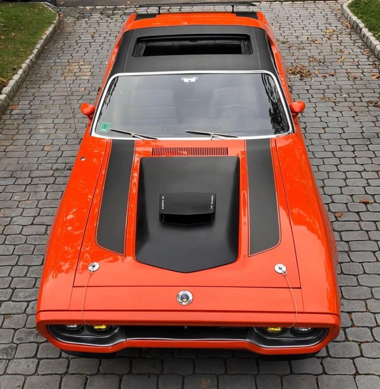 orange dodge muscle car