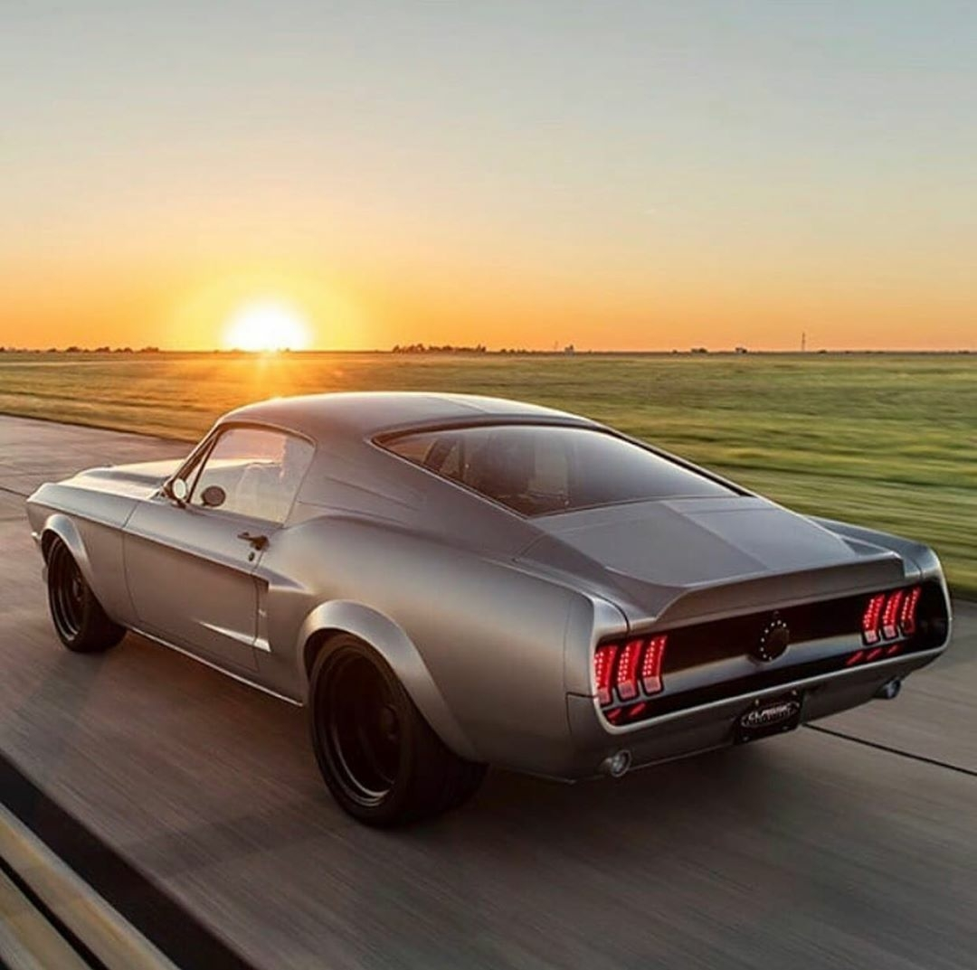 fastback mustang going fast on highway