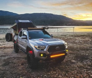 the manly life - tacoma truck camper by lake