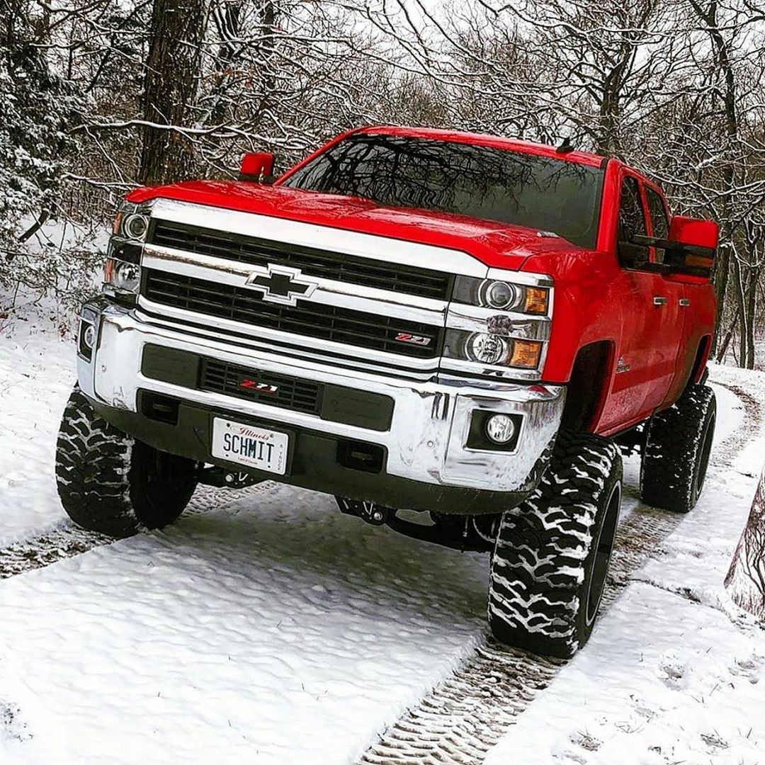 red 2020 silverado in the snow