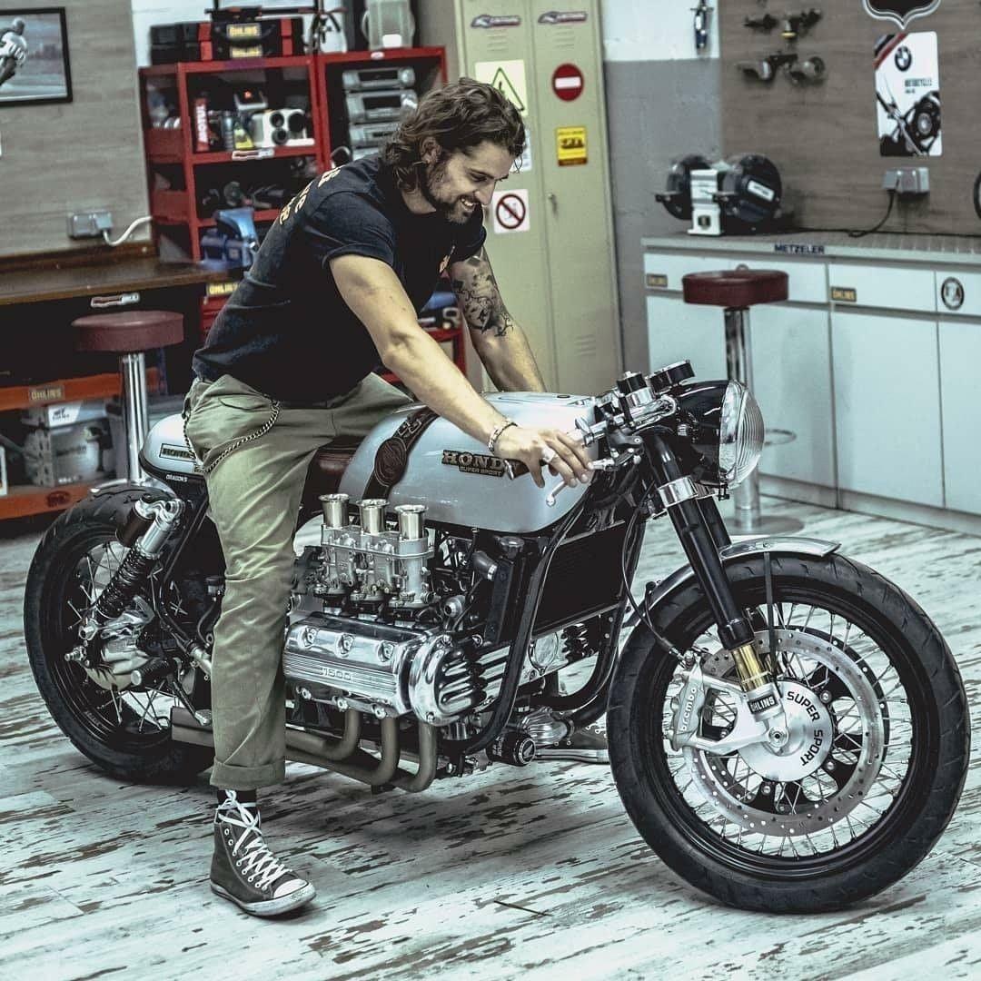 man sitting on honda superbike