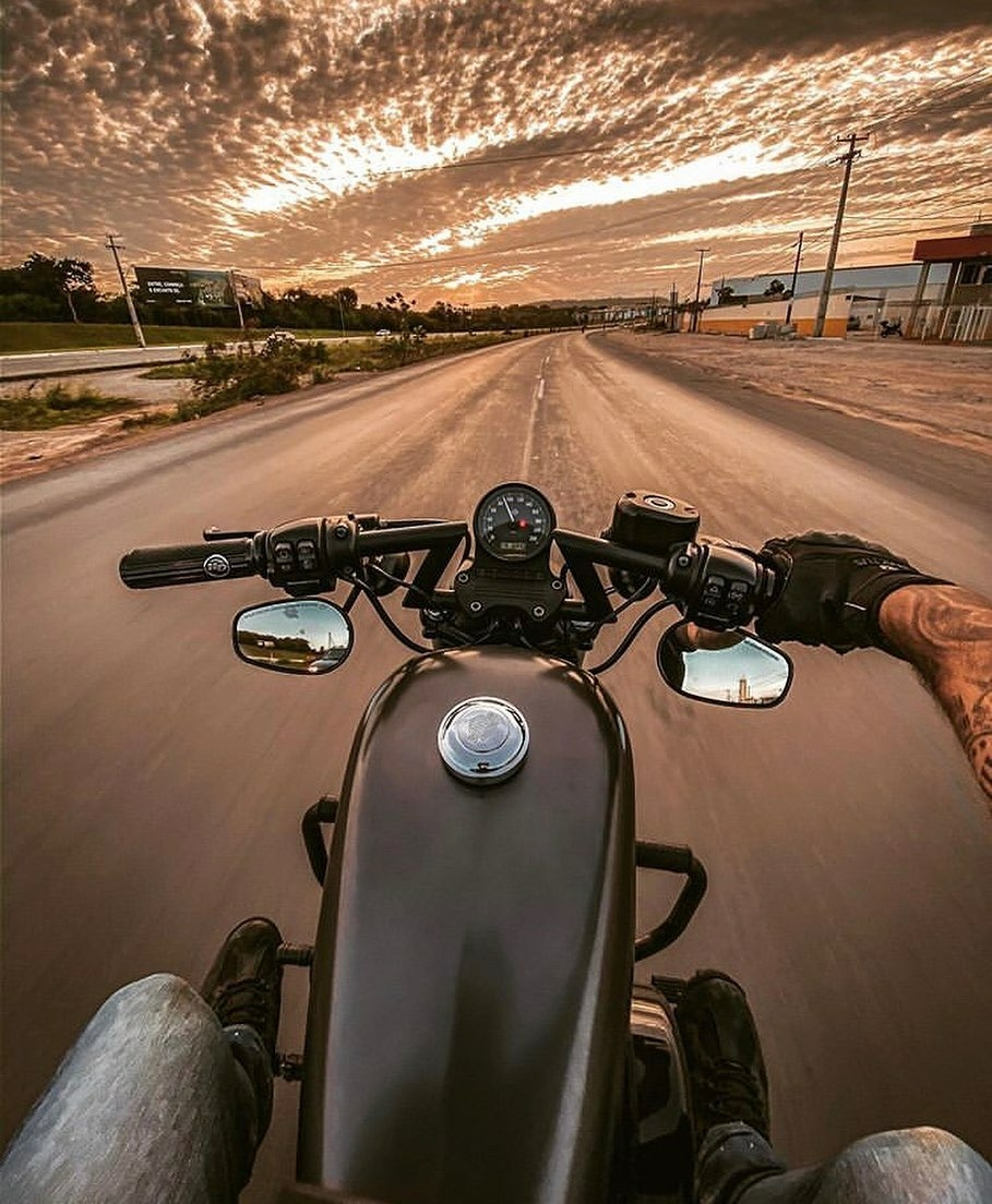 pov man riding motorcycle