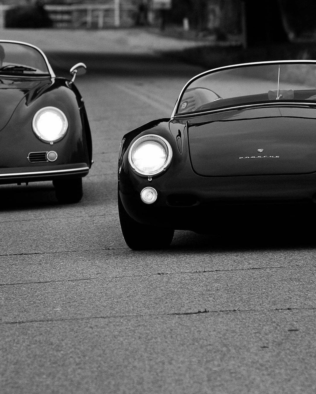 two classic black porsches