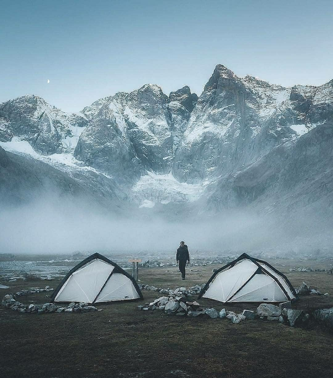two tents in front of mountains