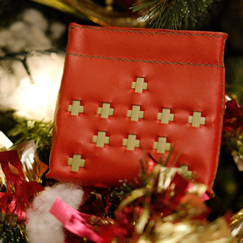 red coin wallet on xmas tree