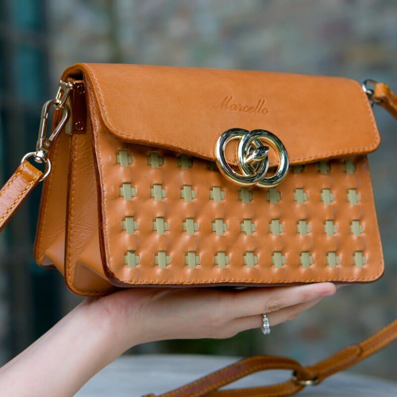 leather mini purse brown in hand