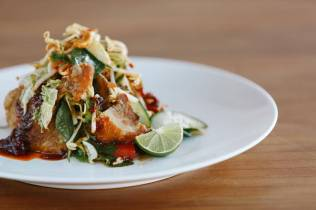Crispy duck salad w watermelon cucumber roasted cashews thai basil chilli jam & lime