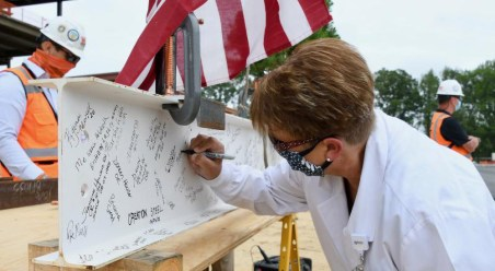 Beebe Healthcare's Vice President and Chief Nursing Officer, Lynn Voskamp, adds her name to the beam.