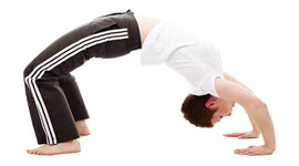 A flexible man doing the bridge pose
