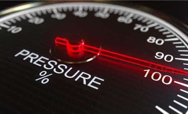 A close up of a pressure gauge