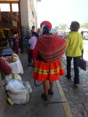 Two women - one traditional Peruvian and one (Gabi) traditional traveler, contrast near the mercado in Ollantaytambo
