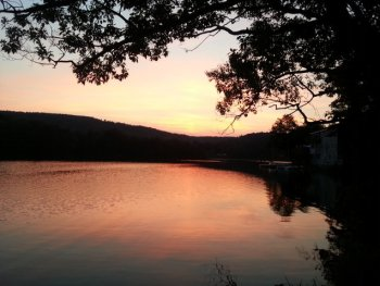 Sunset washes over the calm waters of Ashfield Lake