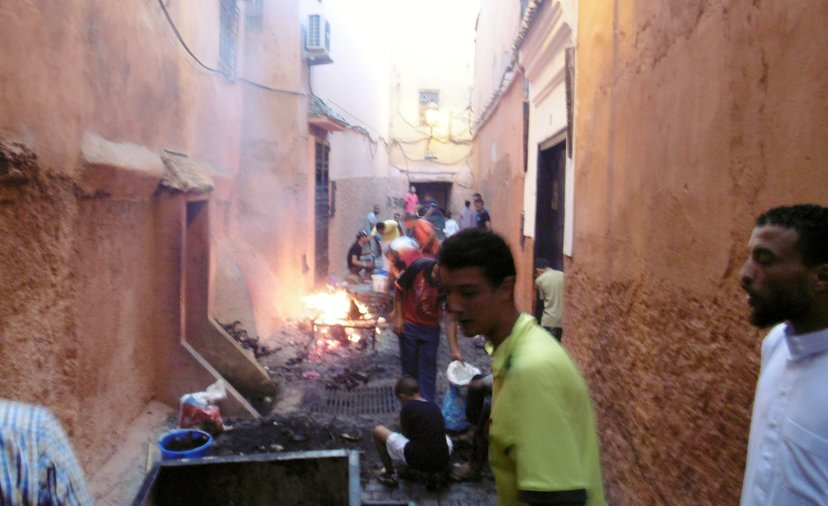Burning sheep and open fires in the street.