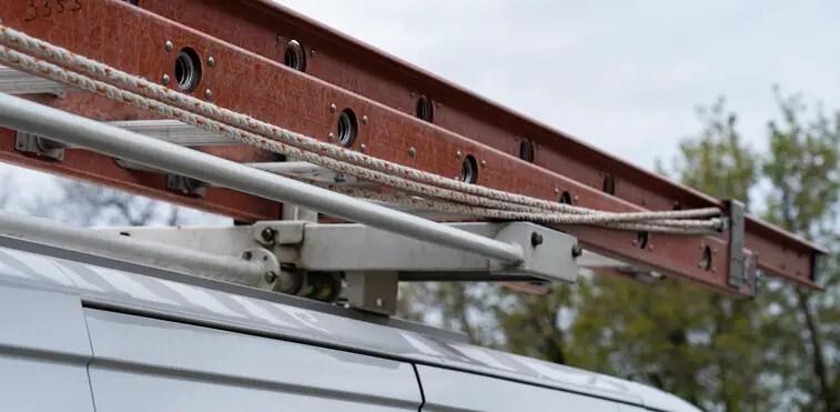 Ladder rack installed on top of a work van