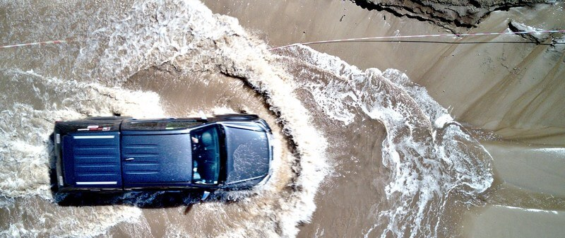 Pickup truck driving in water