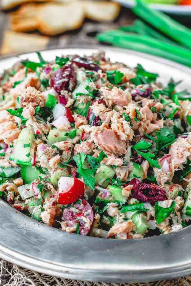 Mediterranean Tuna Salad with fresh herbs, chopped vegetables and a zesty Dijon vinaigrette! The best way to enjoy canned tuna!
