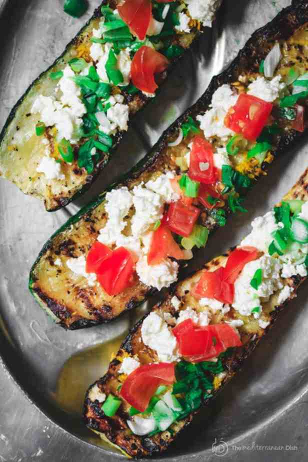 Top Mediterranean Recipe of 2016 | The Mediterranean Dish. Easy Mediterranean Zucchini Boats! See this recipe and all 10 Mediterranean recipes on TheMediterraneanDish.com