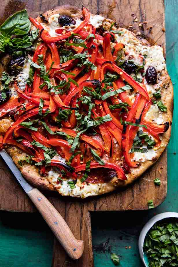 25 Mediterranean Picnic Recipes | The Mediterranean Dish. This Mediterranean Roasted Red Pepper Pizza from Half Baked Harves plus a list of amazing picnic recipes with a Mediterranean twist. Easy, bright, Mediterranean salads; Chickpea salads; Pasta salads; Greek macaroni and cheese; grilled chicken and kofta kabobs; no-mayo zesty tuna; brownies and lemon cakes! See the recipes on TheMediterraneanDish.com