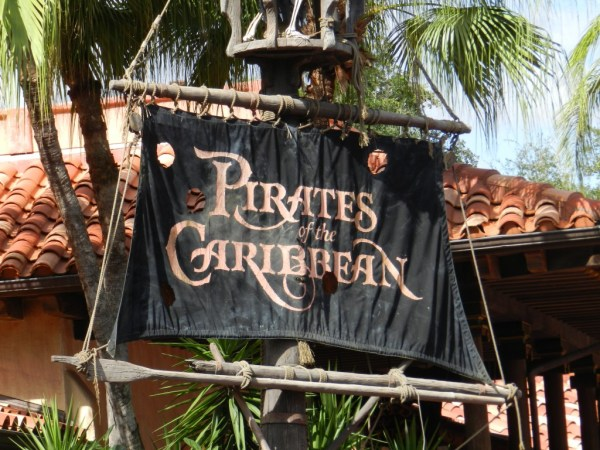 Pirates of the Caribbean black flag with red text at the Magic Kingdom