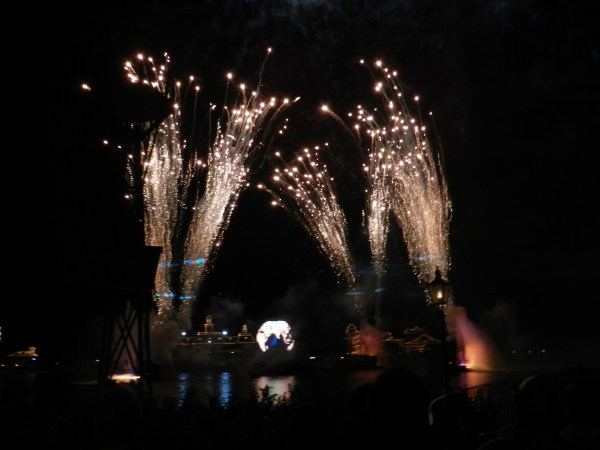Fireworks at Epcot with globe in the center of the World Showcase Lagoon