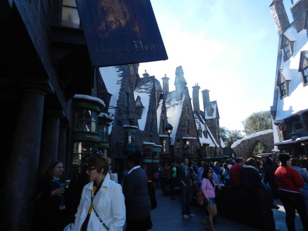 Wizards and witches gathering in Hogsmeade