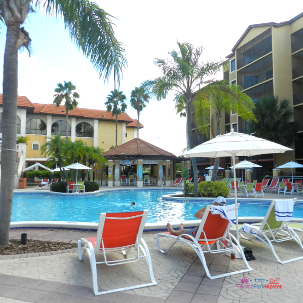Westgate Lakes Resort Villa Orlando pool area with colorful lounge chairs.