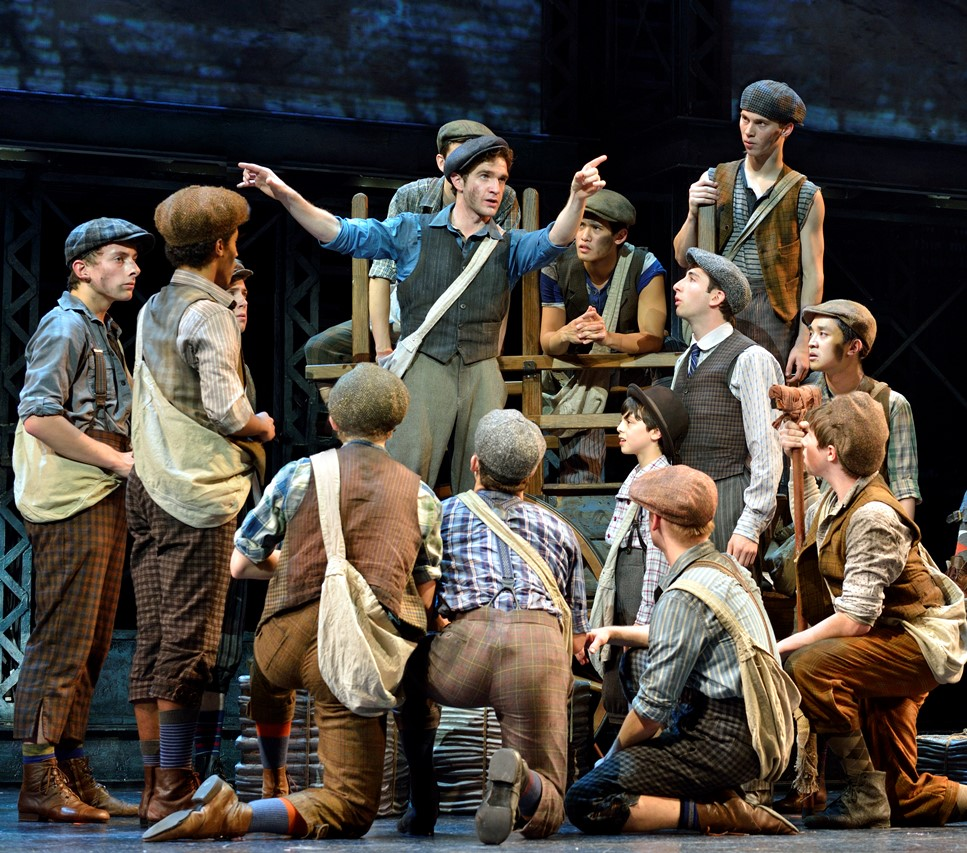 Dan DeLuca (Jack Kelly) (center) and the original North American Tour company of NEWSIES ©Disney //  Photo Courtesy Deen van Meer