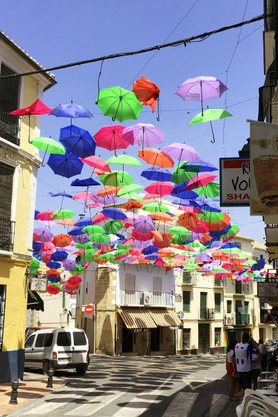 Brightly coloured umbrellas as an awning