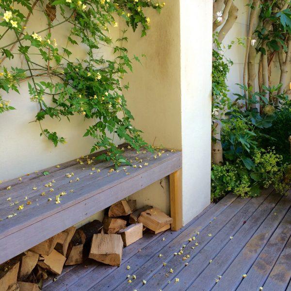 Garden bench as log storage.