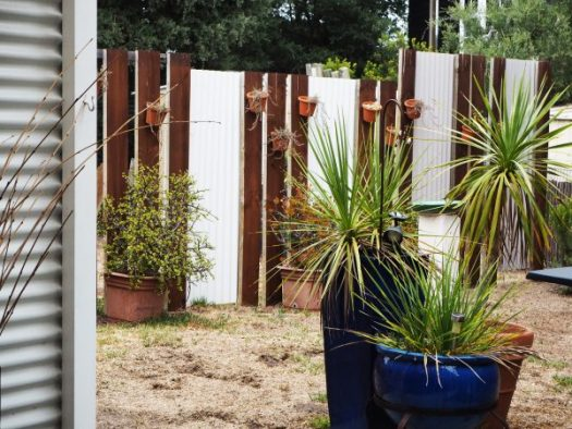 Easy DIY screen with corrugated iron and fence posts.