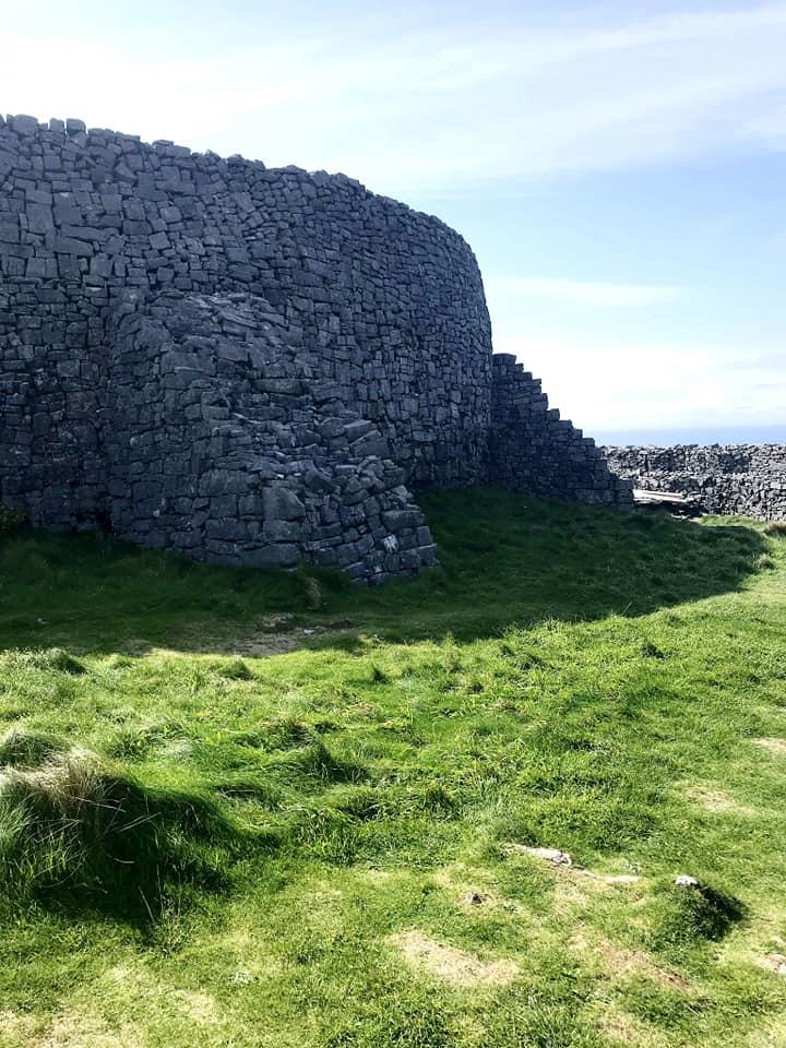 Dun Aonghasa semi-circular prehistoric fort on top of a cliff in Ireland.