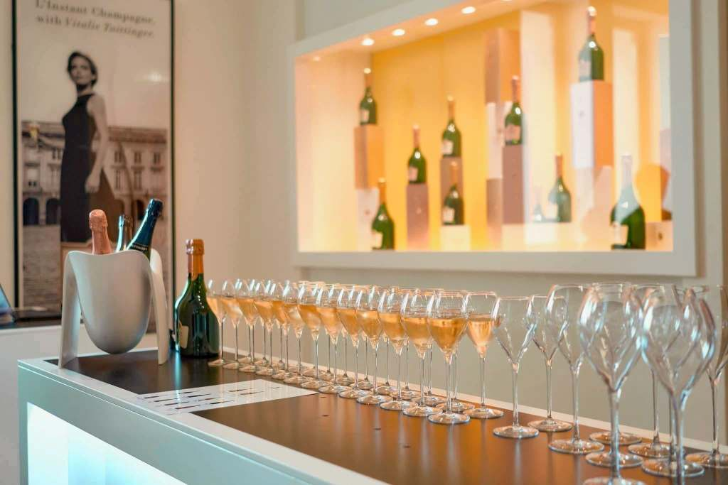 Row of champagne glasses half filled for a tasting at Taittinger Champagne House in Reims, France.