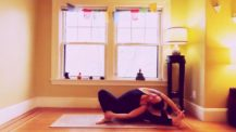 Woman in revolved side bend variation (yoga pose)
