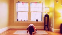 Woman in double pigeon (fire log/agnistambasana) yoga pose