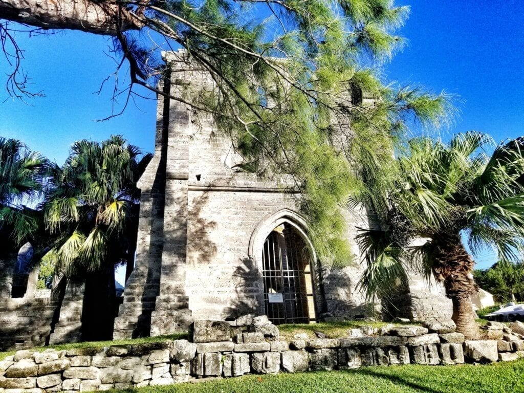 View of the Unfinished Church in St. George's, Bermuda looking through the surrounding pine trees.