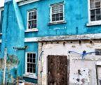 Old, dilapidated bright blue building in St. George's, Bermuda
