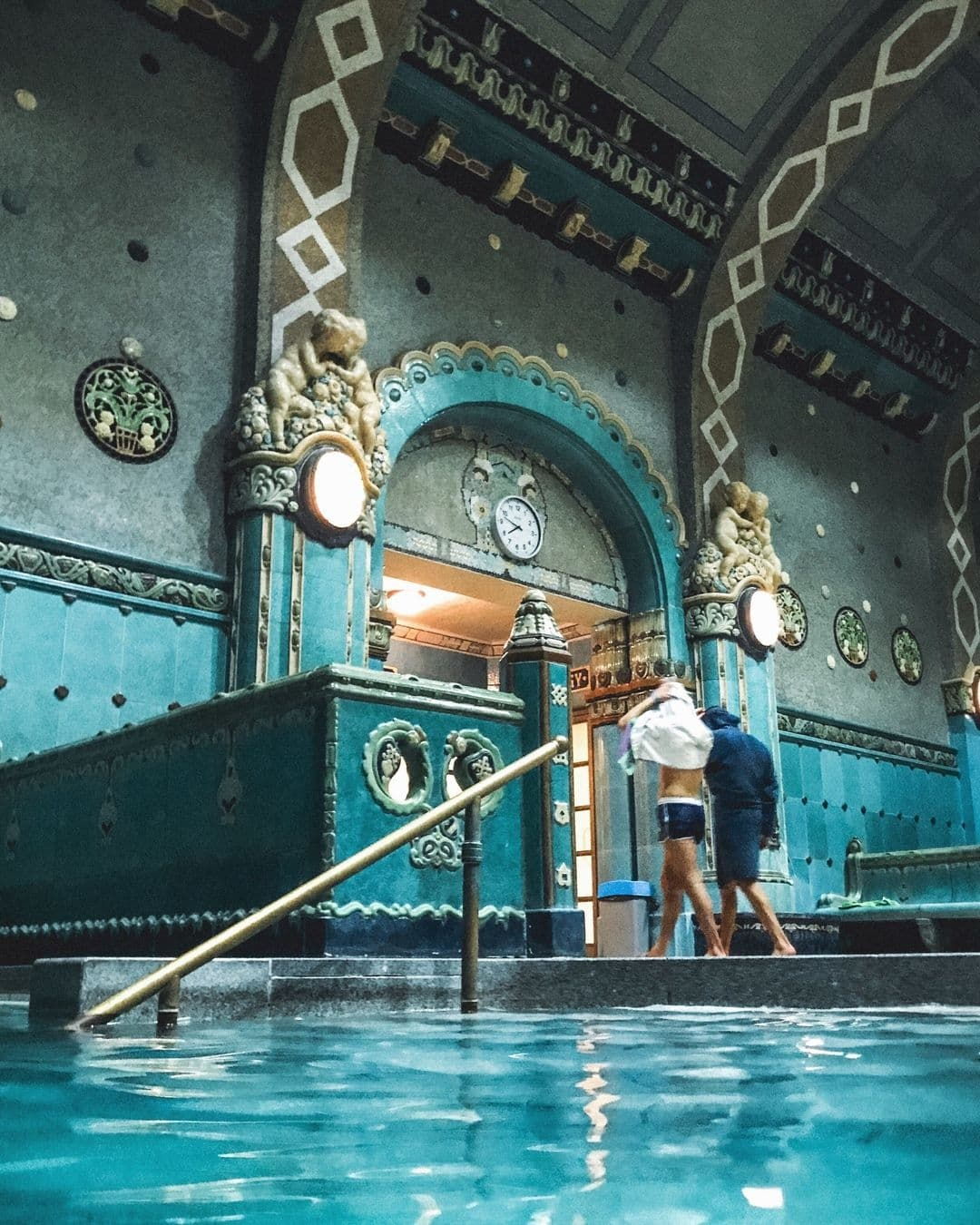 Turquoise, ornate interior of one of Budapest's many thermal spas.