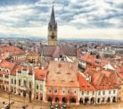 Things to do in Sibiu - Climb the council tower for this view of the red roofs and the Evangelical Church