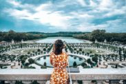 One of the best day trip from Paris - Woman looking out over gardens at Versailles