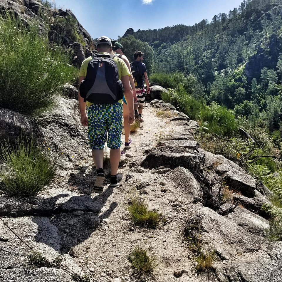 Line of people hiking up a mountain in Portugal