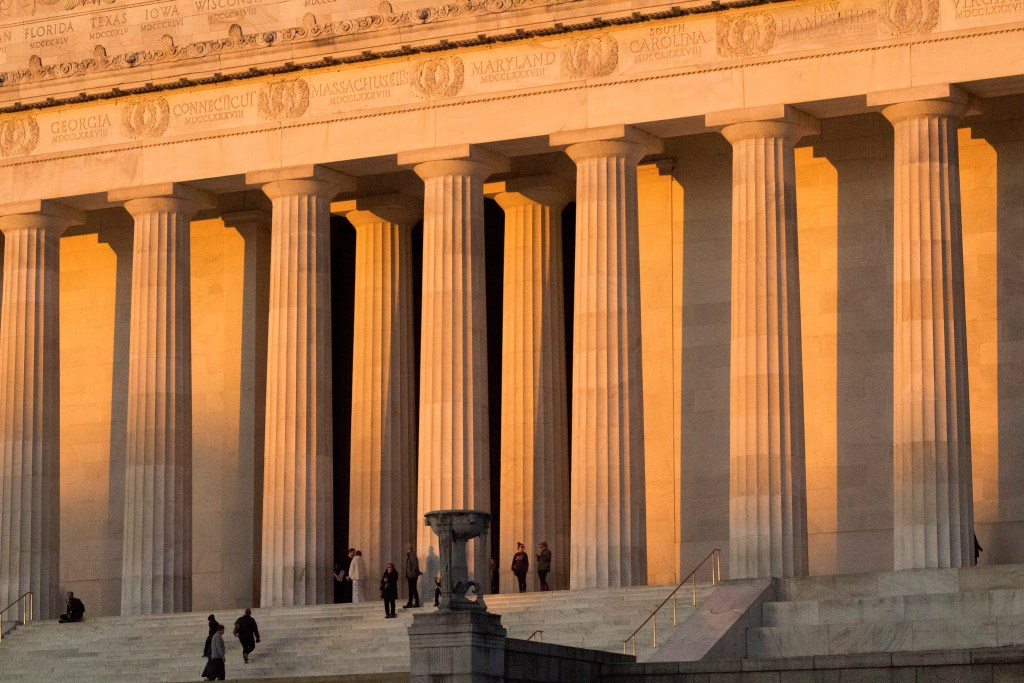 Lincoln Memorial with light pouring through at dusk, DC is a doable day trip from NYC.