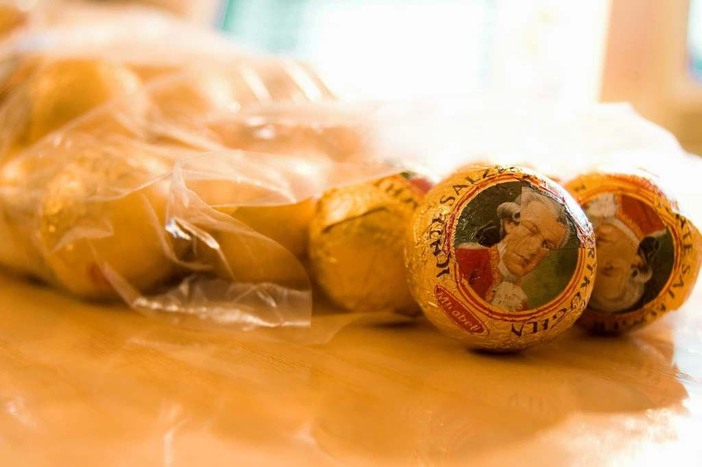 Salzburger Mozartkugeln, an Austrian candy made with pistachio, marzipan, and chocolate.
