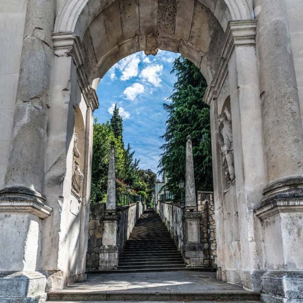 Looking up the many stairs under the Arco delle Scalette in Vicenza, Italy.