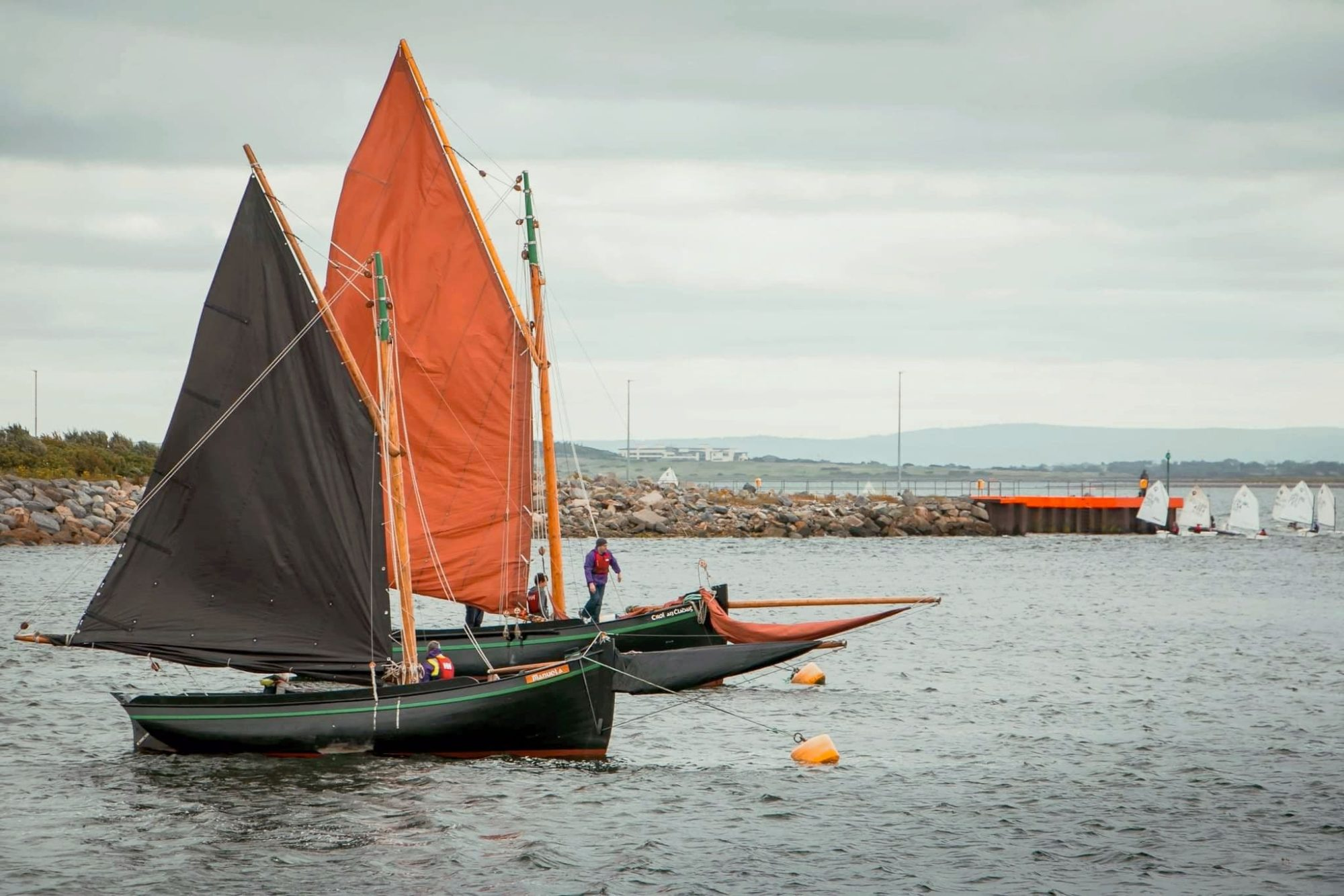 Two Galway Hooker boats sailing on Galway Bay.